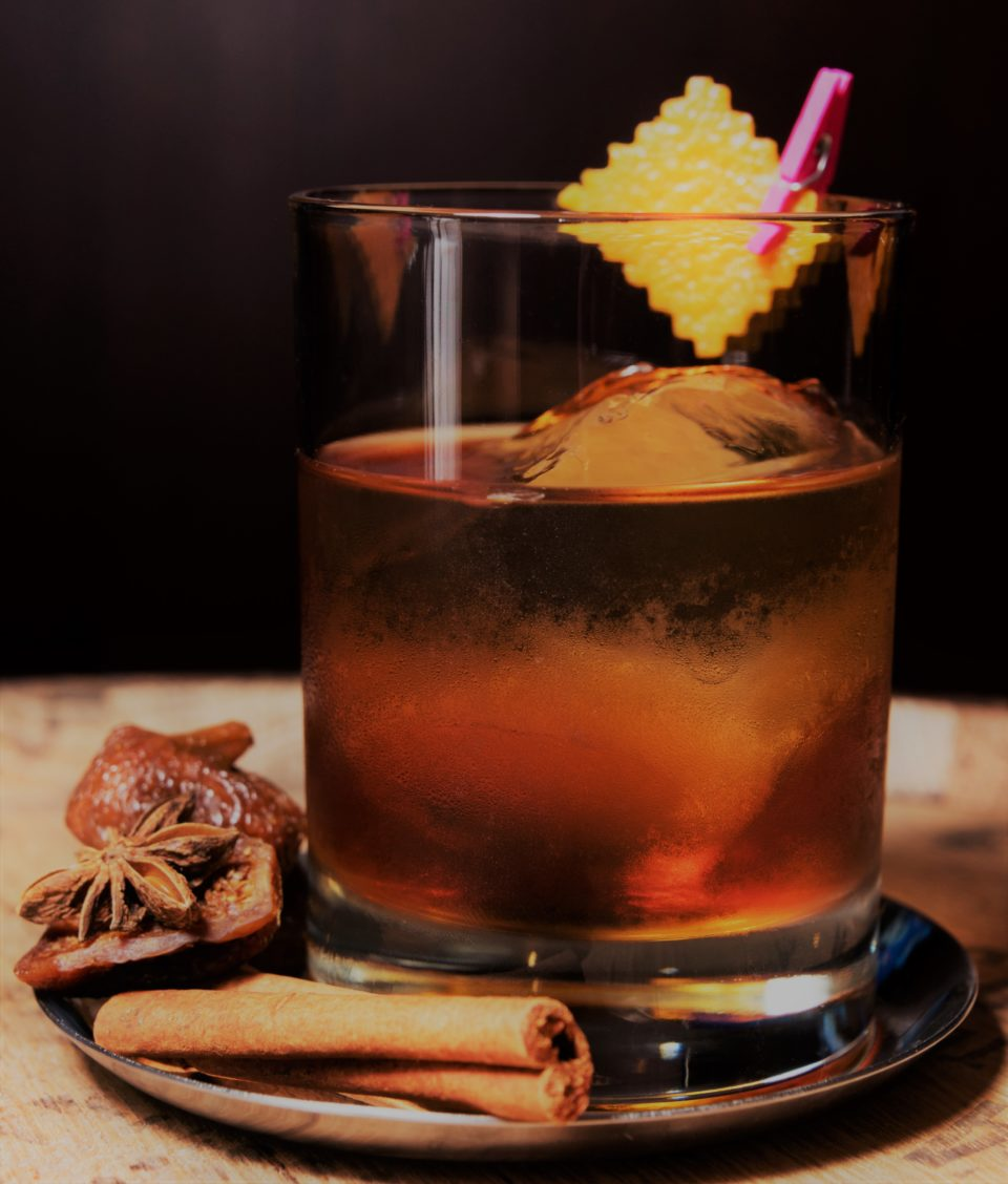 a photo of a smoked old fashioned